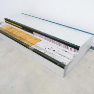 Curb, 2010, wood, steel edges, stickers, 37 × 110 × 240 cm